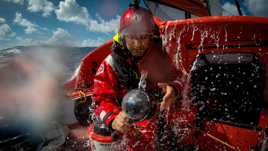 March 19, 2015. Leg 5 to Itajai onboard Dongfeng Race Team. Day 1. Yann Riou taking video on a wet day
