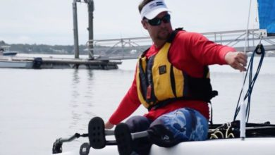 """Photo of Bradley Kendell: """"When I sail, I leave my Wheelchair in the Dock"""""""